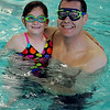 Grace Lohman and her dad, Matt, are styling in their goggles while relaxing in the pool during the Denny Price Family YMCA Date With Dad Saturday, May 18, 2013. (Staff Photo by BONNIE VCULEK)