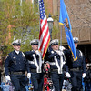 The Enid Police Department Honor Guard posts the colors during the 81st annual Tri-State Parade Saturday, May 4, 2013. Twenty-one marching bands performed during the competition as crowds gathered around the downtown Enid square. (Staff Photo by BONNIE VCULEK)