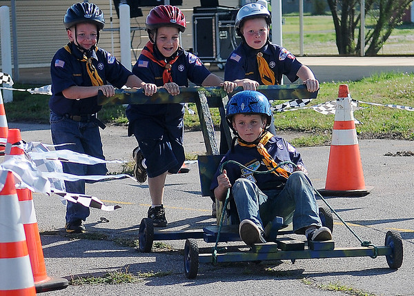 Cub Scouts of America Pack 3 (from left) D.J. Hoopingarner, Garrett Strickland and Sam Akin push the cart as Evan Sullivan steers during the obstacle course races at the Moose Lodge Saturday, May 11, 2013. The young men finished with a time of 21.34 seconds. (Staff Photo by BONNIE VCULEK)