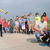 2nd Lt. Cole Evans (right) assists, as McKenzie Sutton's rocket soars into the air during the Prairie View Elementary School students' countdown with each rocket launch Friday, May 10, 2013. Fourth-grade teacher, Lori Painter (back left) praised the volunteers from Vance Air Force Base for their help with her annual project. (Staff Photo by BONNIE VCULEK)