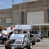 A visitor looks over a sprint race car Sunday during a car show at the Enid Speedway. (Staff Photo by BILLY HEFTON)
