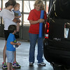 Children (left) wait for their new car seats to be installed during the Safe Kids Oklahoma child car seat safety check at Enid Fire Department's Central Fire Station Wednesday, May 22, 2013. (Staff Photo by BONNIE VCULEK)