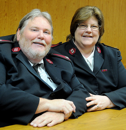 Capt. John Dancer and his wife, Major Geri Dancer (from left) will soon leave their Salvation Army positions in Enid and assume new ones in Georgia. (Staff Photo by BONNIE VCULEK)
