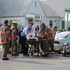 Enid firefighters and Life EMS prepare a gentleman for transport to St. Mary's Regional Medical Center after the motorcycle he was driving collided with a car at the corner of W. Randolph and N. Jefferson Tuesday, May 7, 2013. (Staff Photo by BONNIE VCULEK)