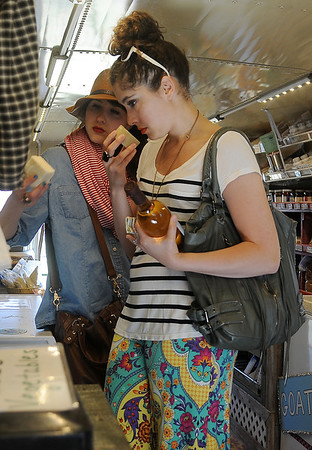 Emily Santos-Silva (left), from Dallas, and Ana Stachowski, from Woodward,  select items for a Mother's Day gift inside the Rowdy Stickhorse bus at Enid Farmers Market Saturday, May 11, 2013. (Staff Photo by BONNIE VCULEK)