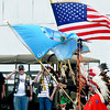Veterans salute as members of the Kiowa Black Leggins Honor Society present the colors during Memorial Day ceremonies at the Woodring Wall of Honor. (Staff Photo by BILLY HEFTON)