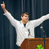 Andrew Andrado salutes his fellow Lincoln Academy Survivors at the end of his speech Tuesday during Senior Appreciation Night. (Staff Photo by BILLY HEFTON)