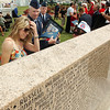 A Gold Star family member see the name of her loved one for the first time on the Woodring Wall of Honor during Memorial Day ceremonies. (Staff Photo by BILLY HEFTON)
