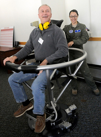 James Ebel (left) reacts after he experiences a graveyard spin in the barany chair by A1C Alysia Uribe at Vance Air Force Base's Aerospace and Operational Physiology facility Friday, May 3, 2013. Ebel and other Enid Public School teachers of the year were treated to a tour of the base and a luncheon during Teacher Appreciation Day. (Staff Photo by BONNIE VCULEK)