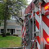 Enid firefighters respond to a fire behind a home at 1115 W. York Tuesday, May 7, 2013. (Staff Photo by BONNIE VCULEK)