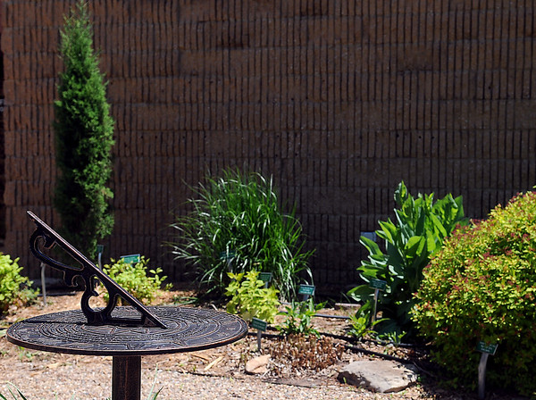The OSU Extension Center, 316 East Oxford features a quaint garden with a sun dial, a variety of plants, and a garden bench. The location is one of the six locations in the Master Gardener of Enid Garden Tours on Friday, May 31 and Saturday, June 1. (Staff Photo by BONNIE VCULEK)