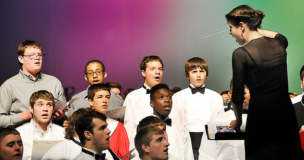 Dr. Irene Messoloras leads the combines honor groups in a musical version of the Pledge of Allegiance during the Tri-State grand concert Saturday at the Enid High School Auditorium. (Staff Photo by BILLY HEFTON)