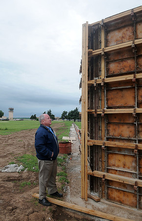Dan Ornesorge surveys the construction of the Vietnam Memorial at Enid Woodring Regional Airport Thursday, May 23, 2013. Funding for the memorial is still needed and committee members will be at Jumbo Foods accepting donations Saturday. (Staff Photo by BONNIE VCULEK)