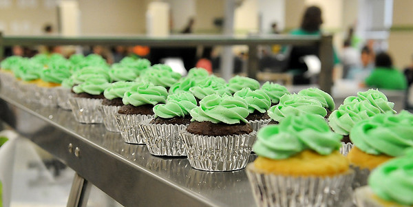 More than 600 cupcakes were served to students, faculty and guests during Emerson Middle School's 90th birthday celebration Friday, May 17, 2013. (Staff Photo by BONNIE VCULEK)