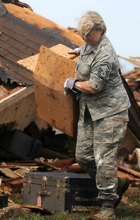 Army National Guard Cherry Bina salvages belongings from her home at 6th and Telephone Road Tuesday, May 21, 2013. Moore and Oklahoma City residents began the clean-up after an F5 tornado caused massive destruction over a 30 square mile area Monday afternoon, killing 24 including 9 school-age children. (Staff Photo by BONNIE VCULEK)