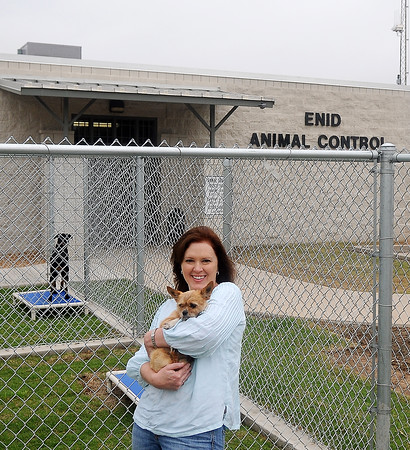 April Danahy holds one of the puppies available for adoption at the Enid Animal Control's new exercise pens Saturday, May 18, 2013. (Staff Photo by BONNIE VCULEK)