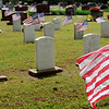 American flags mark the graves of World War Veterans at Enid Cemetery Saturday, May 25, 2013. Enid High School athletes placed the flags on the graves for Memorial Day. (Staff Photo by BONNIE VCULEK)