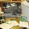 A 1923 photograph of Emerson Middle School and other memorabilia greets guests as they enter the office for the school's 90th birthday celebration Friday, May 17, 2013. (Staff Photo by BONNIE VCULEK)