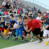 Boys from several Enid elementary schools sprint away from the starting line during the 800 meter run at the 73rd annual Kiwanis Little Olympics at D. Bruce Selby Stadium Wednesday, May 8, 2013. (Staff Photo by BONNIE VCULEK)
