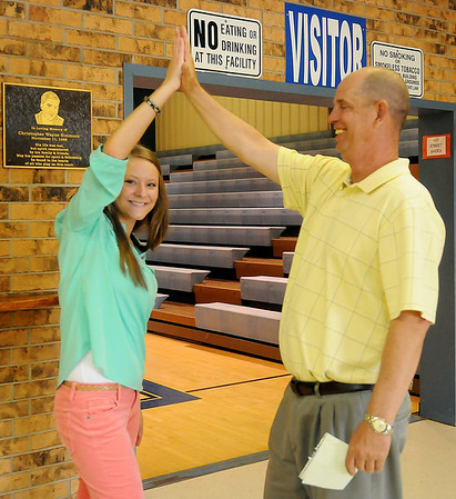 Peyton Isbell, Waukomis High School student art award winner, with her video production instructor Philip Pond (Staff Photo by BONNIE VCULEK)