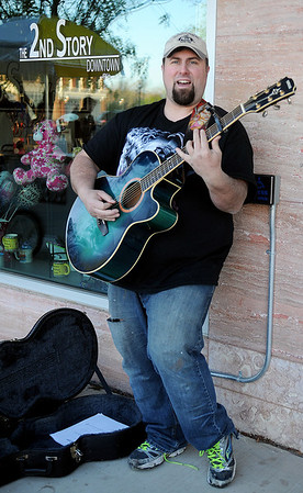 Jason Taylor performs outside 4RKids 2nd Story Downtown during the Tri-State Music Festival and Main Street Enid's First Friday Jazz Stroll in downtown Enid May 3, 2013. (Staff Photo by BONNIE VCULEK)