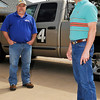 Mike and Bobby Bennett stand next to their storm chasing truck Sunday in Enid. (Staff Photo by BILLY HEFTON)