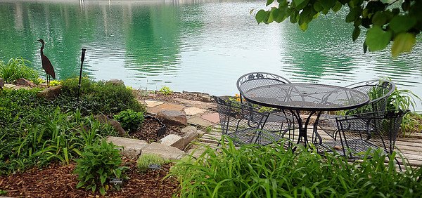 Jon and Diane Ford's backyard garden includes private seating areas overlooking Willow Lake and several man-made water features at 3619 Willow Lake Lane. (Staff Photo by BONNIE VCULEK)