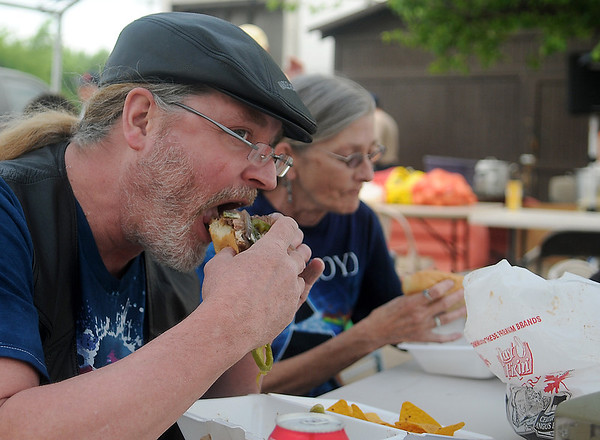 Marvin and Deborah Balleu, from Enid, enjoy ribeye steak sandwiches and steamed crawfish during the 3d annual AMBUCS Crawfish Boil at Jumbo Foods Saturday, May 18, 2013. (Staff Photo by BONNIE VCULEK)