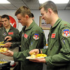 Student pilots 2nd Lt. Jonathan Payne and 2nd Lt. Eli Weyen (front, from left) prepare their barbecue pulled pork and cheese nachos during the 3rd Flying Training Squadron's N-Flight Nacho Friday at Vance Air Force Base May 3, 2013. Payne and Weyen are both members of Class 13-13. (Staff Photo by BONNIE VCULEK)