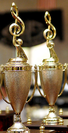 To the victor go the spoils. Trophies await the winners following the Tri-State grand concert Saturday at the Enid High School Auditorium. (Staff Photo by BILLY HEFTON)