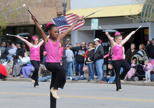 Twirlers from the Enid Twirling Academy perform in front of the Tri-State Million Dollar Parade crowd in downtown Enid, Saturday, May 4, 2013. (Staff Photo by BONNIE VCULEK)