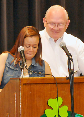 Lincoln Academy principal, Jarry Hillman, comforts Emma Gates as she tears up during her speech Tuesday during Senior Appreciation Night. (Staff Photo by BILLY HEFTON)