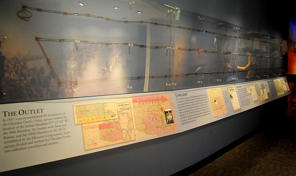 """Cherokee Strip Regional Heritage Center's new exhibit """"Surveys of the Outlet and Surveying Chains,"""" on loan from Northern Oklahoma College, is located across from The Drake Land Run Theatre in the museum. (Staff Photo by BONNIE VCULEK)"""