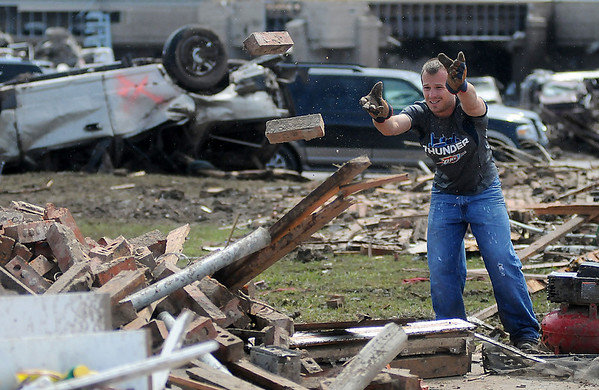 Clean up began early Tuesday morning after a massive tornado devastated the community of Moore, Oklahoma Monday, May 20, 2013. Twenty-four are confirmed dead, nine of those are children. (Staff Photo by BONNIE VCULEK)