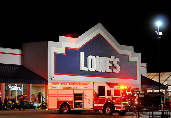 Units of the Enid Fire Department responded to a fire at Lowe's Tuesday night. (Staff Photo by BILLY HEFTON)