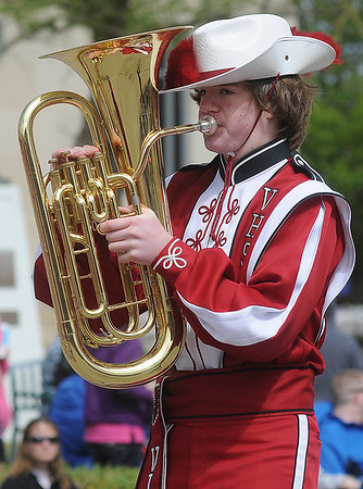 A Vici High School tuba player passes the judges' stand during the 81st annual Tri-State Million Dollar Parade Saturday, May 4, 2013. (Staff Photo by BONNIE VCULEK)