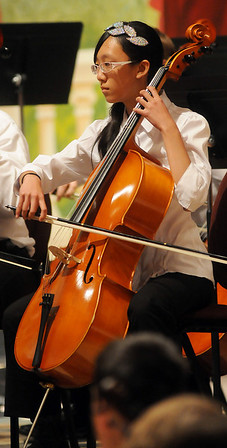 Jessica Fan plays her cello during Summit Middle School's Tri-State Music Festival orchestra competition at the Enid Symphony Center Thursday, May 2, 2013. (Staff Photo by BONNIE VCULEK)