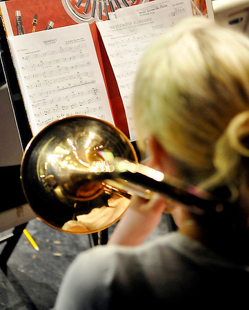 A trombonists performs during the Tri-State grand concert Saturday at the Enid High School Auditorium. (Staff Photo by BILLY HEFTON)