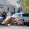 Enid firefighters and Life EMS prepare a gentleman for transport to St. Mary's Regional Medical Center after the motorcycle he was driving collided with a car at the corner of W. Randolph and N. Jefferson Tuesday, May 7, 2013. The crash is under investigation by the Enid Police Department. (Staff Photo by BONNIE VCULEK)