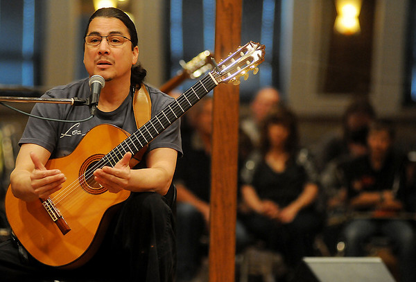 Edgar Cruz, a renowned classical guitarist, hosts a guitar clinic in the Highland Partners Ballroom during the Tri-State Music Festival Friday, May 3, 2013. (Staff Photo by BONNIE VCULEK)