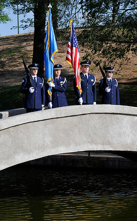The Enid High School Junior ROTC Color Guard presents the colors during the annual May Fete ceremony at Government Springs Park Tuesday. (Staff Photo by BILLY HEFTON)