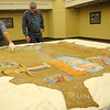 David Kennedy (left), Cherokee Strip Regional Heritage Center curator of collections, examines a large buffalo hide with Albert Stehno at the museum Wednesday, May 8, 2013. Stehno, co-author of The Vanished Herd - a history of the Cherokee Strip Cowpunchers' Association and Cattlemen and Drovers of early-day Oklahoma, explained that the buffalo was killed on the 101 Ranch in the 1920s and the hide was donated and designed with names of the Cherokee Strip Cowpunchers between 1932-1934. (Staff Photo by BONNIE VCULEK)