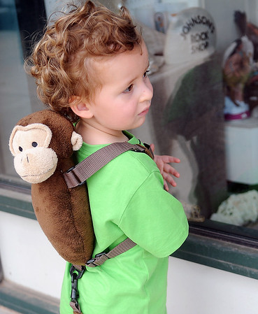 Colt Williams sports a monkey on his back as he glances inside Johnson's Jewelry and Rock Shop Wednesday, May 29, 2013. Williams, who lives in Corpis Christy, Tex. has been in Enid visiting his great-grandparents. (Staff Photo by BONNIE VCULEK)