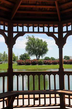 The Alvarado Ranch gazebo offers a spectacular view of the beautiful landscaped yard of Jose' and Magdalena Alvarado Wednesday, May 22, 2013. The Master Gardener of Enid Garden Tours on Friday, May 31 and Saturday, June 1 will feature six yards, including the Alvarado Ranch. (Staff Photo by BONNIE VCULEK)