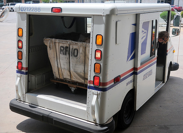 Enid Mail Carrier Sharon Frye backs her truck up to the Enid Post Office docking area as she prepares to unload the collected food items from her mail route Saturday, May 11, 2013. Area carriers collected more than 13,000 pounds of food for the Horn of Plenty during Stamp Out Hunger. (Staff Photo by BONNIE VCULEK)