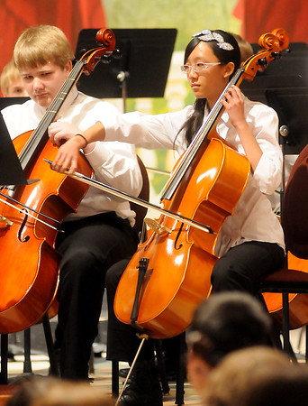 Summit Middle School orchestra student, Jessica Fan, plays her cello during the 81st annual Tri-State Music Festival at the Enid Symphony Center Thursday, May 2, 2013. (Staff Photo by BONNIE VCULEK)