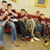 Traben Redgate, Trey Green, Kolten Childers, Kody Mackey, Kellen Allison, Garrison George and Brock Long (from left), with Waynoka School's fifth and sixth grade band members, relax before they plan their solos, trios or brass ensemble selections during Tri-State Music Festival competitions at Central Christian Church Wednesday, May 1, 2013. (Staff Photo by BONNIE VCULEK)