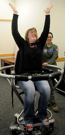 Kathryn Dorton, Adams Elementary School's teacher of the year, experiences a corolis illusion in the barany chair at the Aerospace & Operational Physiology facility during the 2nd annual Enid Public School Teacher Appreciation Day at Vance Air Force Base Friday, May 3, 2013. (Staff Photo by BONNIE VCULEK)