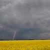 A streak of lightening from an approaching thunderstorm looking southwest on south Oakwood Rd. Wednesday. (Staff Photo by BILLY HEFTON)