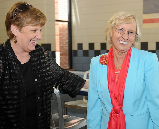 Eddie Lou Strimple, Enid Public Schools' 2013 Teacher of the Year, shares a laugh with Dr. Ruth Ann Erdner during a reception honoring Dr. Erdner for her 43 years of service for Enid children at the Enid High School food court Friday, May 31, 2013. (Staff Photo by BONNIE VCULEK)